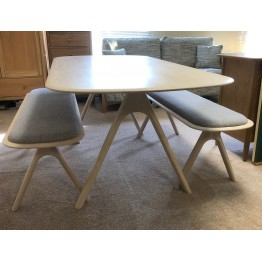 SHOWROOM CLEARANCE ITEM - Ercol Furniture Corso Medium Dining Table with 2 Benches with upholstered top.