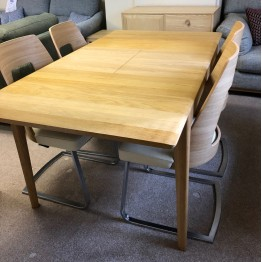 SHOWROOM CLEARANCE ITEM - Ercol Furniture Romana Dining Table and 4 Cantilver Leather Chairs